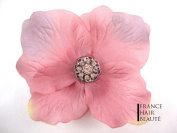 1. Antique Pink Hair Flower Hair Accessories and Jewellery. Flower Antique Pink 9 Crystals at the heart of the flower Repositionable Mounting Cold and with Clip. 1 per order.