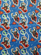 1 Yard - Superman and the Superman logo, flying around the Earth on Blue Cotton Fabric - Officially Licenced (Great for Quilting, Sewing, Craft Projects, Throw Pillows & More) 1 Yard X 110cm Wide