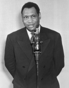 1941 photo Paul Robeson, half-length portrait, facing front, standing before microphone shaped like a bottle of Coca-Cola . Vintage 8x10 Photograph - Ready to Frame