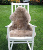 LANABEST premium sheepskin, colour taupe (brown-beige). Top Quality. Real leather with unshaven, especially soft, warm and cosy First year's wool. Very low-odour. An eye-catcher for every sofa. Relief while sitting. A great gift for every day.