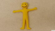 24x Yellow Smiley Stretchy Men Toys / Party Goody Bag Fillers Lucky Dip Fun