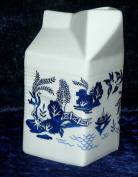 Milk carton shaped jug off white ceramic decorated with blue willow patten