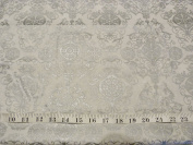 Joann's White with a shiny silver Damask style design on 100% cotton fabric