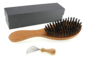 Exclusive long-bristle brush from local pearwood with wild boar bristles, including comb cleaner with metal bristles in a black gift box.