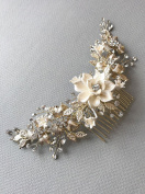 USABride Bridal hair comb offers a luminous touch of nature inspired beauty to your bridal look This headpiece features ivory enamel flowers accented with gold-plated frosted leaves TC-2303-G