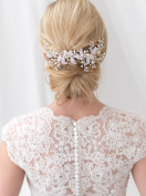 USABride Comb offers a timeless touch of nature to your wedding look This hair comb features jewelled leaves accented with hand-wired branches of rhinestones and simulated freshwater pearls TC-2306