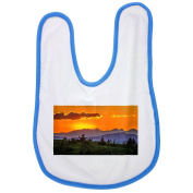 Sunset, Trees, Landscape, Mountains baby bib in blue