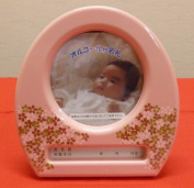 03-O-02 where it is for a music box photo frame doll