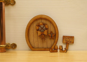 North Pole Fairy Door. Three-dimensional Self-Assembly Wooden Fairy Door Craft Kit with Holly Wreath, 'North Pole' Sign & Elf Boots.