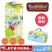 A car runs on Yookidoo rail; look; and play mat