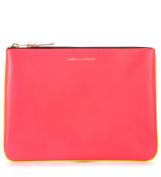 Bustina Comme des Garçons Wallet in pelle rosa e gialla fluo
