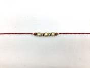 Diamante and Red Beaded Rakhi with Pearl and Golden Cover Effect Rakhi Thread